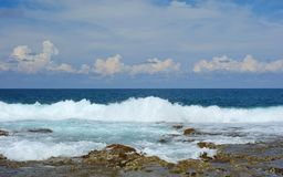 Atoll. A thrilling wave of the Pacific Ocean on the island of Siargao, Philippines Royalty Free Stock Photo