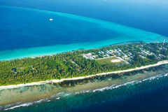 Atolls and islands in Maldives from aerial view Royalty Free Stock Photos