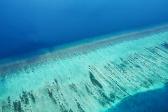 Atolls and islands in Maldives from aerial view Stock Photos