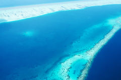 Atolls and islands in Maldives from aerial view Royalty Free Stock Photo