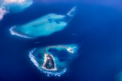 Atolls of the Maldives from above with clouds royalty free stock photography