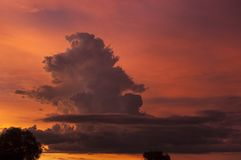 Atom bomb shape cloud in this surreal sunset. stock photography
