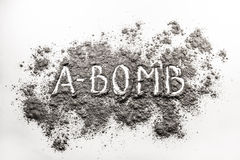 Atom bomb word written in explosion ash, dust cloud Stock Photos