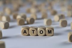 Atom - cube with letters, sign with wooden cubes Stock Photo