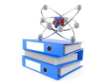 Atom model on stack of ring binders Royalty Free Stock Images