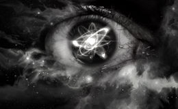 Atom Particle Eyes. Atomic particle reflection in the pupil of an eye for physics background Stock Photo
