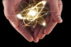 Atom Particle Hands fotografia de stock