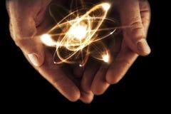 Atom Particle Hands foto de stock