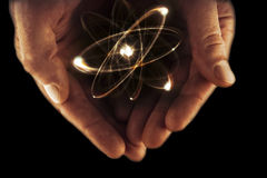 Atom Particle Hands Stock Image