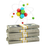 Atom structure on stack of money Stock Photography