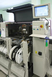 Atomated surface mounting machine. Surface mounting machine applies elements on mainboard stock photo