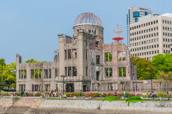 Atomic Bomb Dome. Hiroshima, Japan - April 28, 2013: Tourists walk between the river and Royalty Free Stock Image