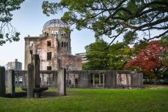 The Atomic Bomb Dome in Hiroshima, Japan. The ruin of the Atomic Bomb Dome in Hiroshima at sunset on the side of Motoyasu River in Japan, a symbol of the stock image