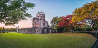 The Atomic Bomb Dome in Hiroshima and the surrounding garden in autumn at sunset. On the side of Motoyasu River in Japan, with the Peace Memorial Park on the stock photos