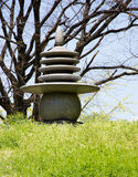 Atomic Bomb Memorial Mound. The concrete pagoda finial atop the Atomic Bomb Memorial Mound in Hiroshima Japan where thousands of cremated remains have been Royalty Free Stock Photo