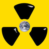 Atomic Bomb Threat. Concept featuring earth inside nuclear symbol Royalty Free Stock Photography