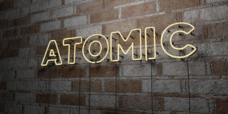 ATOMIC - Glowing Neon Sign on stonework wall - 3D rendered royalty free stock illustration Stock Images