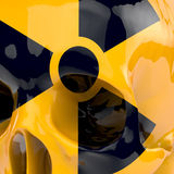 Atomic skull. Radioactive sign on yellow lacquered skull, detail, zoomed, 3d rendering Royalty Free Stock Photography