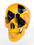 Atomic skull. Yellow lacquered skull with black radioactive sign Royalty Free Stock Photo