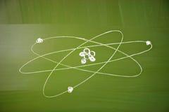 Atomic structure sketch on school blackboard stock photo