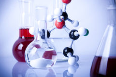 Atoms!. Atoms and flasks witch fluid in laboratory Royalty Free Stock Photos