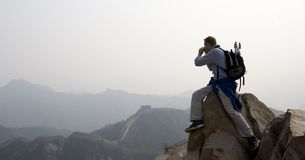 Atop the Great Wall. Man taking pictures or video atop the Great Wall of China Royalty Free Stock Image