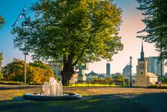 Atop of a hill overlooking mediecal Tallinn, Estonia. A beautiful sunny day atop a hill in medieval Old Towne Tallinn. Estonia royalty free stock image