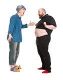 Ator Dressed como o herói do conto de fadas que fala com Fatman Fotos de Stock
