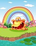 Atpond asustadizo del monstruo y un arco iris en el cielo Fotografía de archivo