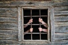 Atrás das barras da prisão Fotografia de Stock Royalty Free