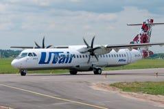 ATR-72 plane. Kiev, Ukraine - July 01, 2013. The passenger ATR-72 plane of the UTair-Express company Royalty Free Stock Images
