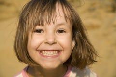 atractive女孩一点微笑 免版税图库摄影