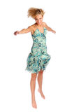 Atractive blonde woman in blue patterned dress. On the white background Stock Photos