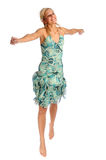 Atractive blonde woman in blue patterned dress. On the white background Stock Image