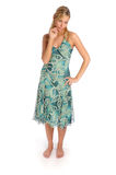 Atractive blonde woman in blue patterned dress. On the white background Royalty Free Stock Image