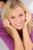 Atractive blonde woman in violet sweater Royalty Free Stock Image