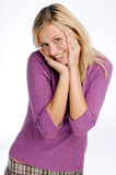 Atractive blonde woman in violet sweater Stock Photo