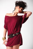 Atractive brunette in red dress Stock Images