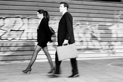 Business people walking in the street. Couple working Royalty Free Stock Photos