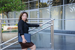 Atractive Business woman with black document case standing on th Royalty Free Stock Images