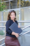 Atractive Business woman with black document case standing on th Royalty Free Stock Photos
