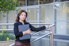Atractive Business woman with black document case standing on th Royalty Free Stock Image