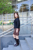 Atractive Business woman standing on the stairs of office buildi Royalty Free Stock Images