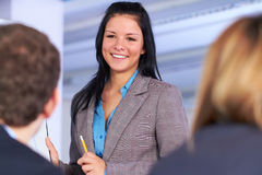 Atractive businesswoman standing next to flipchart Royalty Free Stock Photography