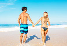 Atractive Couple Having Fun on the Beach Royalty Free Stock Photography