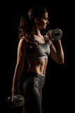 Atractive fit woman works out with dumbbells as a fitness concep Royalty Free Stock Images