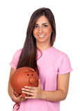 Atractive girl with a big piggy-bank. Isolated on white background Stock Photography