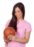 Atractive girl with a big piggy-bank Royalty Free Stock Images