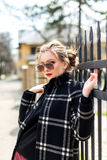Atractive girl in black coat and sunglasses Royalty Free Stock Photos