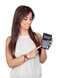Atractive girl with a calculator Royalty Free Stock Photography